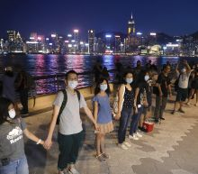 The Latest: Baltic protest inspires Hong Kong human chain