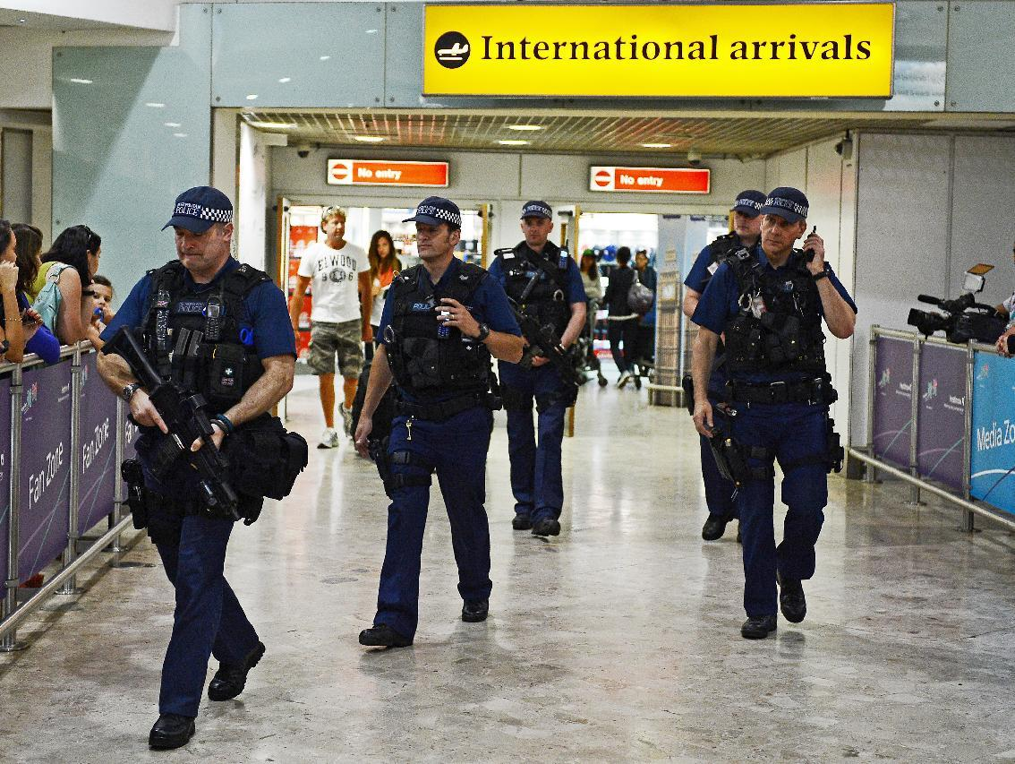 Britain has bolstered security at its airports following a US warning that extremist Islamic groups could have developed new explosives for attacks (AFP Photo/Carl de Souza)