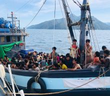 Malaysia detains boatload of 202 presumed Rohingya refugees