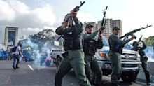 PHOTOS: Uprising in Venezuela as troops join opposition leaders on the streets