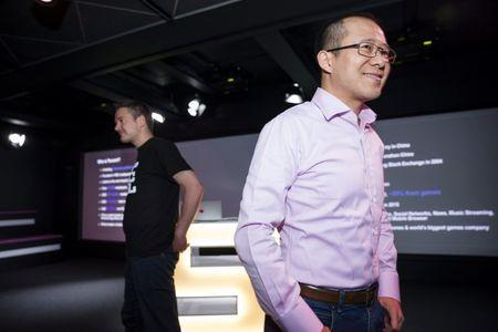 Finnish game company Supercell Co-Founder and CEO Ilkka Paananen (L) and Martin Lau, President of Tencent, meet with press in the company's headquarters in Helsinki, Finland June 21, 2016. Chinese Internet firm Tencent will acquire majority stake in Clash of Clans maker Supercell from Japan's SoftBank. Lehtikuva/Seppo Samuli/via REUTERS
