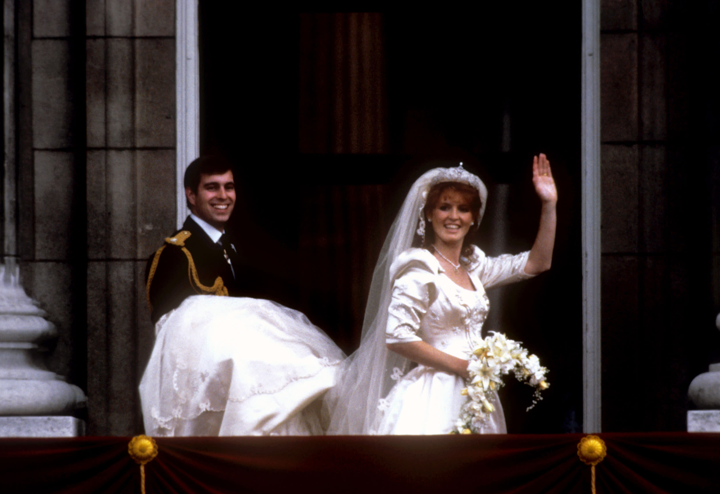 The newly created Duke of York and Duchess of York wave from the balcony of Buckingham Palace after their marriage at Westminster Abbey.