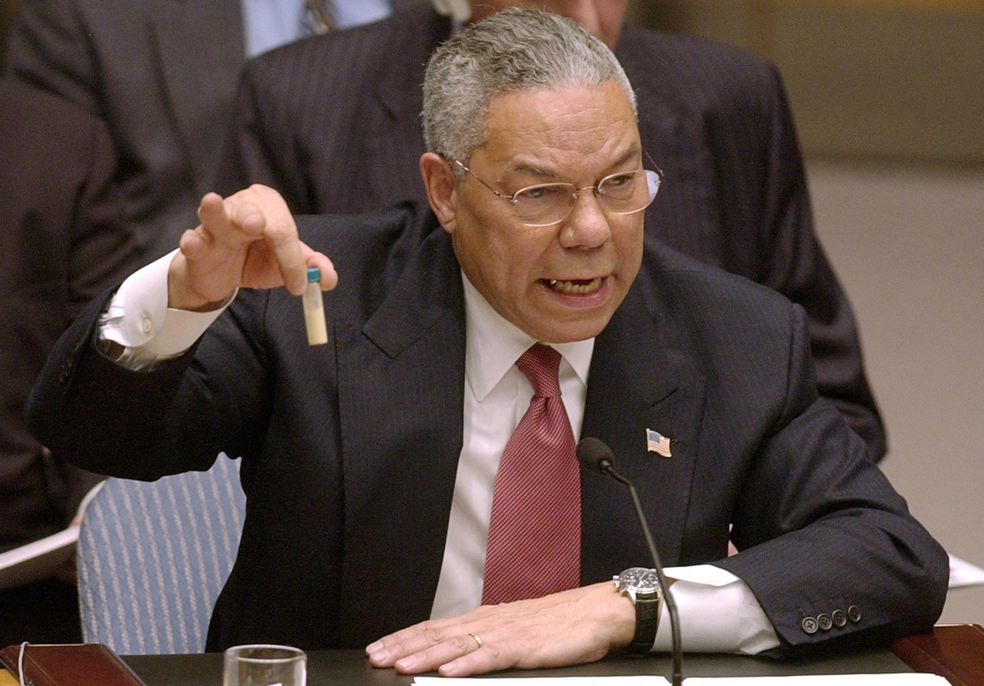FILE - Secretary of State Colin Powell holds up a vial he said could contain anthrax as he presents evidence of Iraq's alleged weapons programs to the United Nations Security Council in this Feb. 5, 2003 file photo. Israeli Prime Minister Benjamin Netanyahu's use of a cartoon-like drawing of a bomb to convey a message over Iran's disputed nuclear program this week, follows in a long and storied tradition of leaders and diplomats using props to make their points at the United Nations. (AP Photo/Elise Amendola, File)