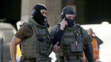 German police say hostage suspect lit explosive, had record