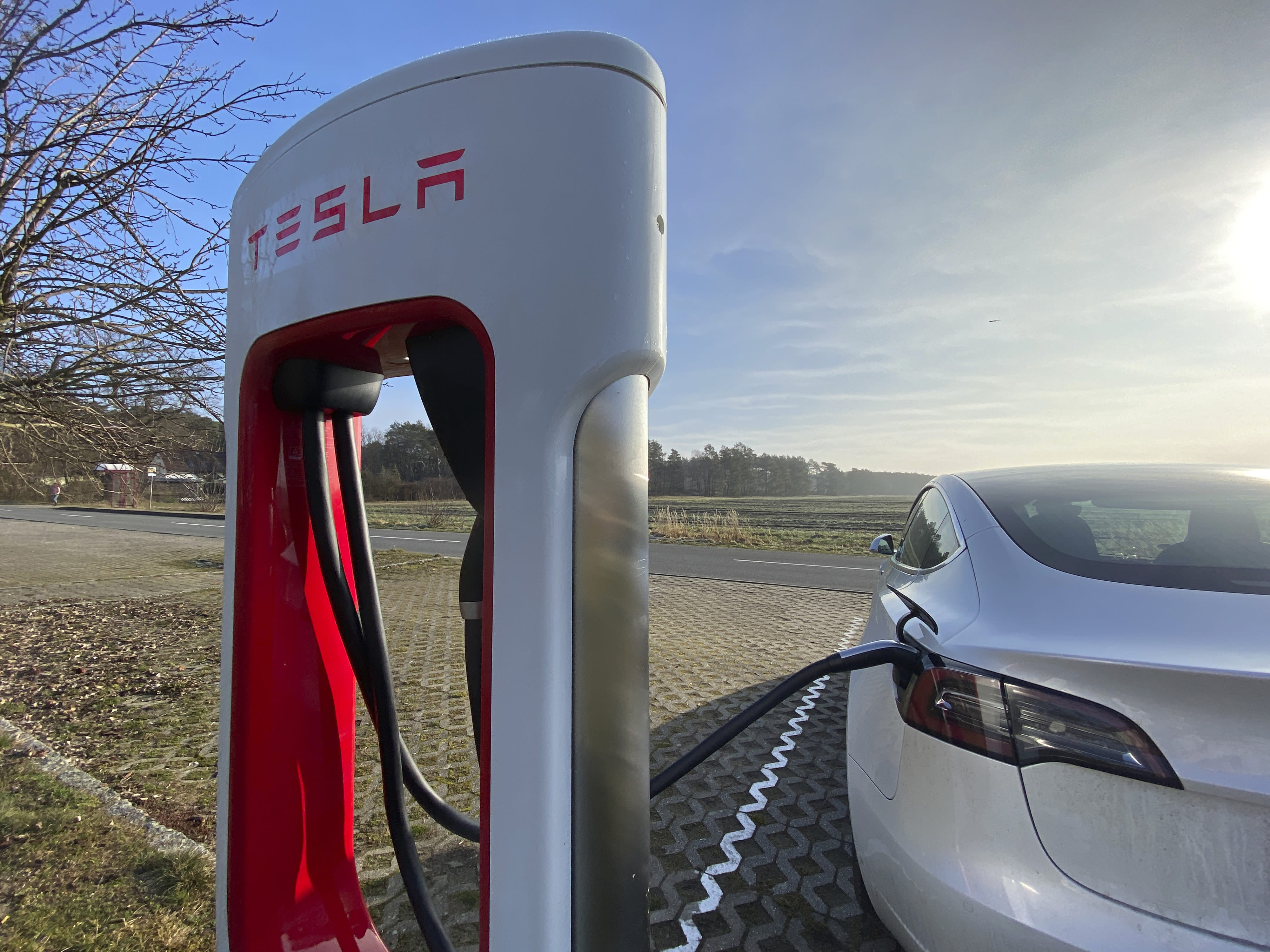 BERSTELAND, GERMANY - MARCH 02: A Tesla Model 3 plugged in and charging at a Supercharger rapid battery charging station for electric vehicles in Bersteland, Germany, on March 02, 2021. (Photo by Thomas Koehler/Photothek via Getty Images)