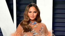 Chrissy Teigen: I was terrified to learn I was pregnant during breast surgery