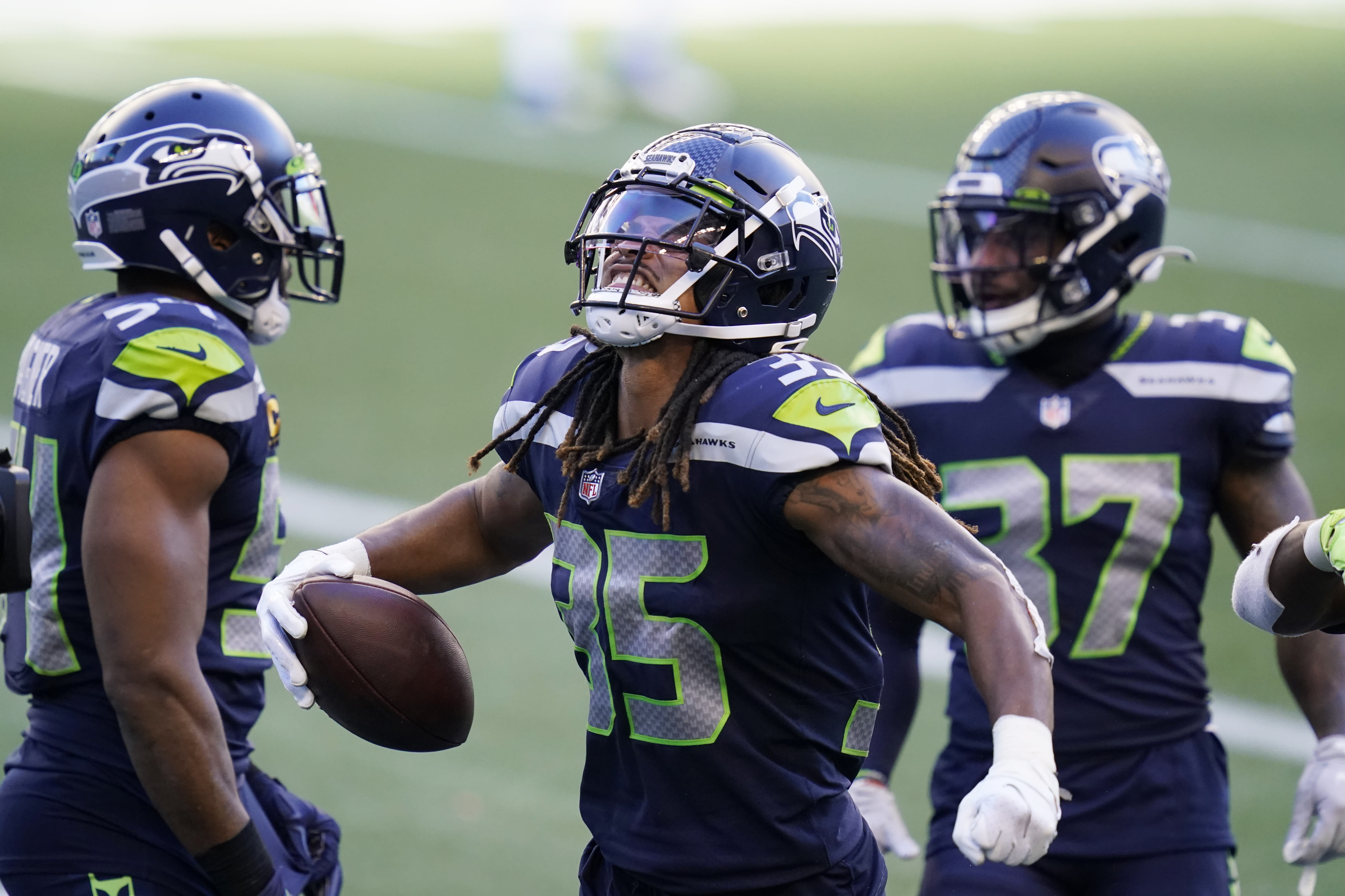 Seattle Seahawks cornerback Ryan Neal celebrates after he intercepted a pass late in the second half of an NFL football game against the Dallas Cowboys, Sunday, Sept. 27, 2020, in Seattle. The Seahawks won 38-31. (AP Photo/Elaine Thompson)