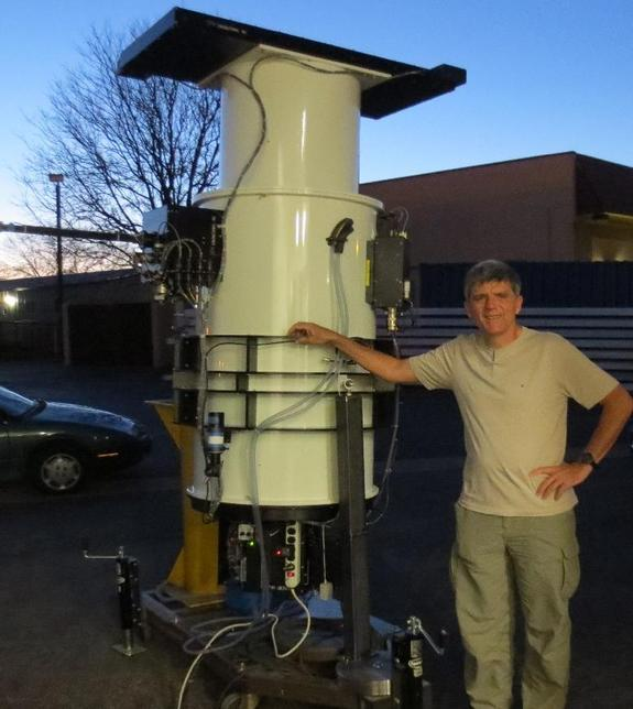 Astro-technologist, John Tonry, with nearly-complete ATLAS 1 telescope at Colorado-based DFM Engineering in late March.