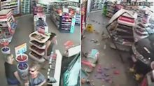 People millimetres from disaster as car smashes through petrol station