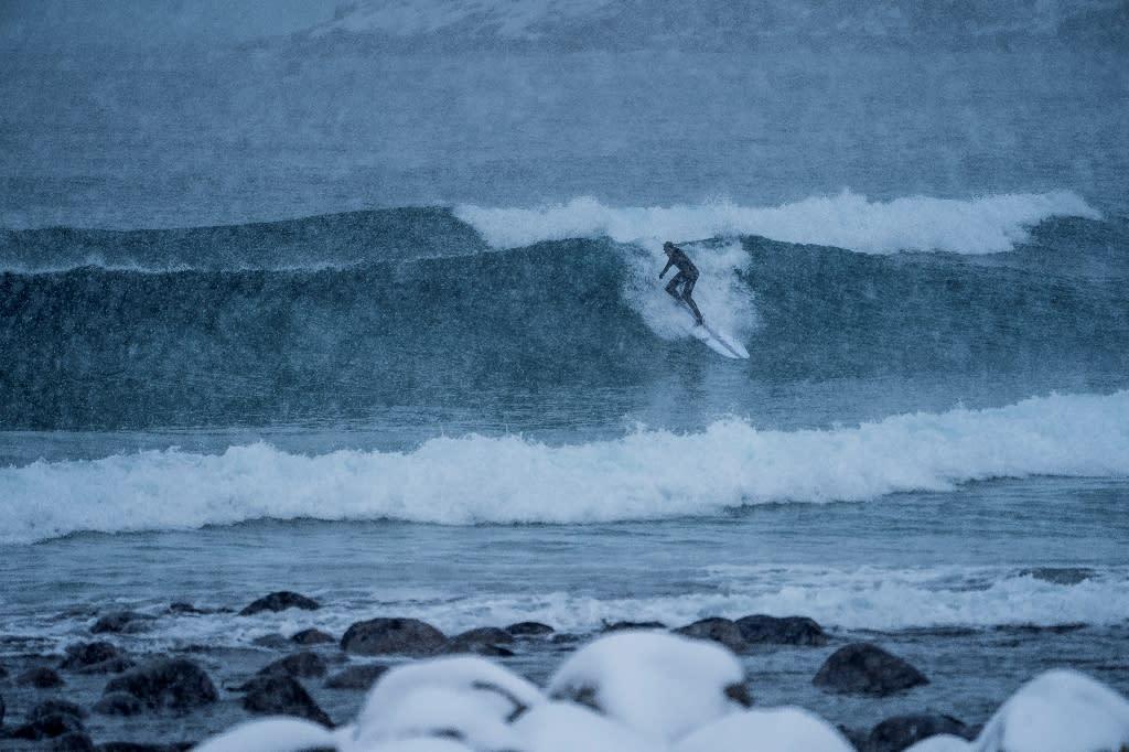 ARCTIC SURFERS RIDE GLACIAL WAVES