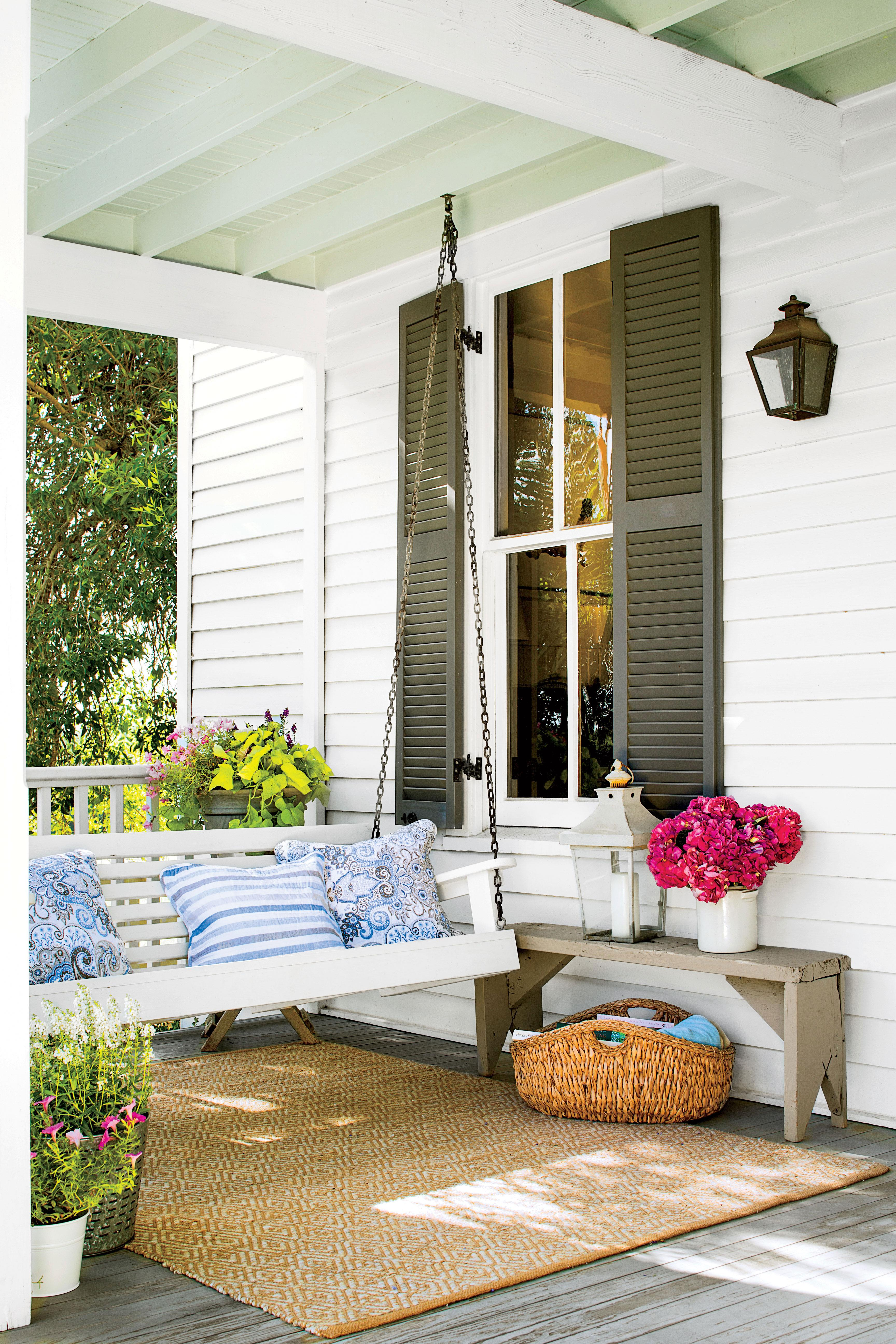 <p>A swing and small bench are all this Texas Farmhouse porch needs.</p>