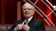 Buffett defends investments in stocks, which fueled record Berkshire profit