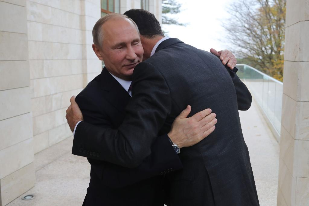 Russia's President Vladimir Putin embraces his Syrian counterpart Bashar al-Assad during a meeting in Sochi last month (AFP Photo/Mikhail KLIMENTYEV)