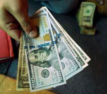 Dollar falls on rising euro, higher U.S. stocks