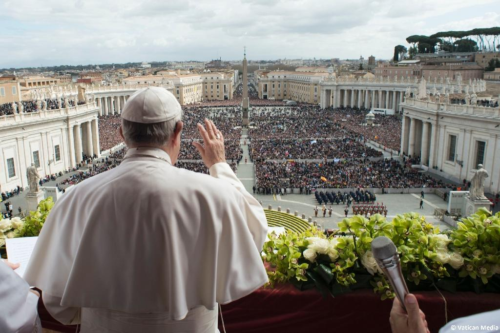 """Pope Francis delivers the """"Urbi et Orbi"""" blessing to 80,000 pilgrims in St Peter's Square, as well as the millions watching the broadcast around the world (AFP Photo/HO)"""