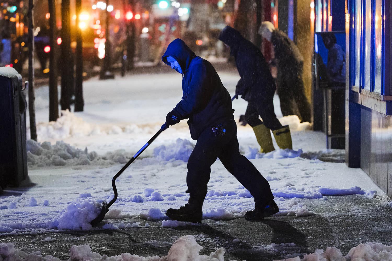 <p>Workmen clear a sidewalk during a winter storm in Philadelphia, Tuesday, March 14, 2017. (Matt Rourke/AP) </p>