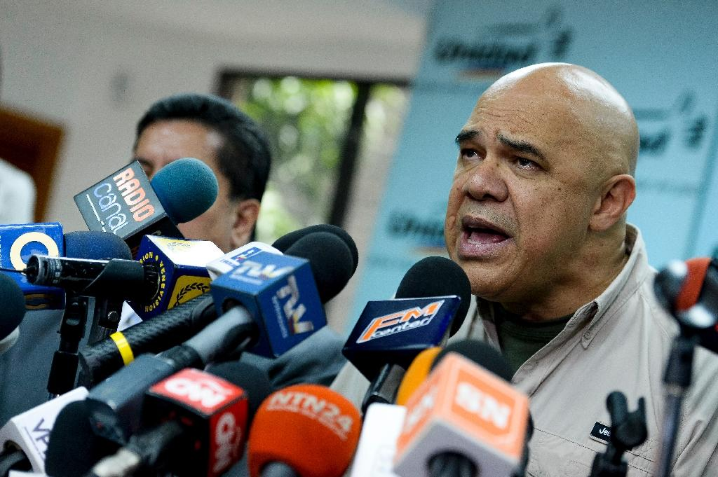 """""""What is coming now is a massive, peaceful, overwhelming, forceful protest,"""" said MUD spokesman Jesus Torrealba, pictured at a press conference in Caracas on September 15, 2016 (AFP Photo/Federico Parra)"""