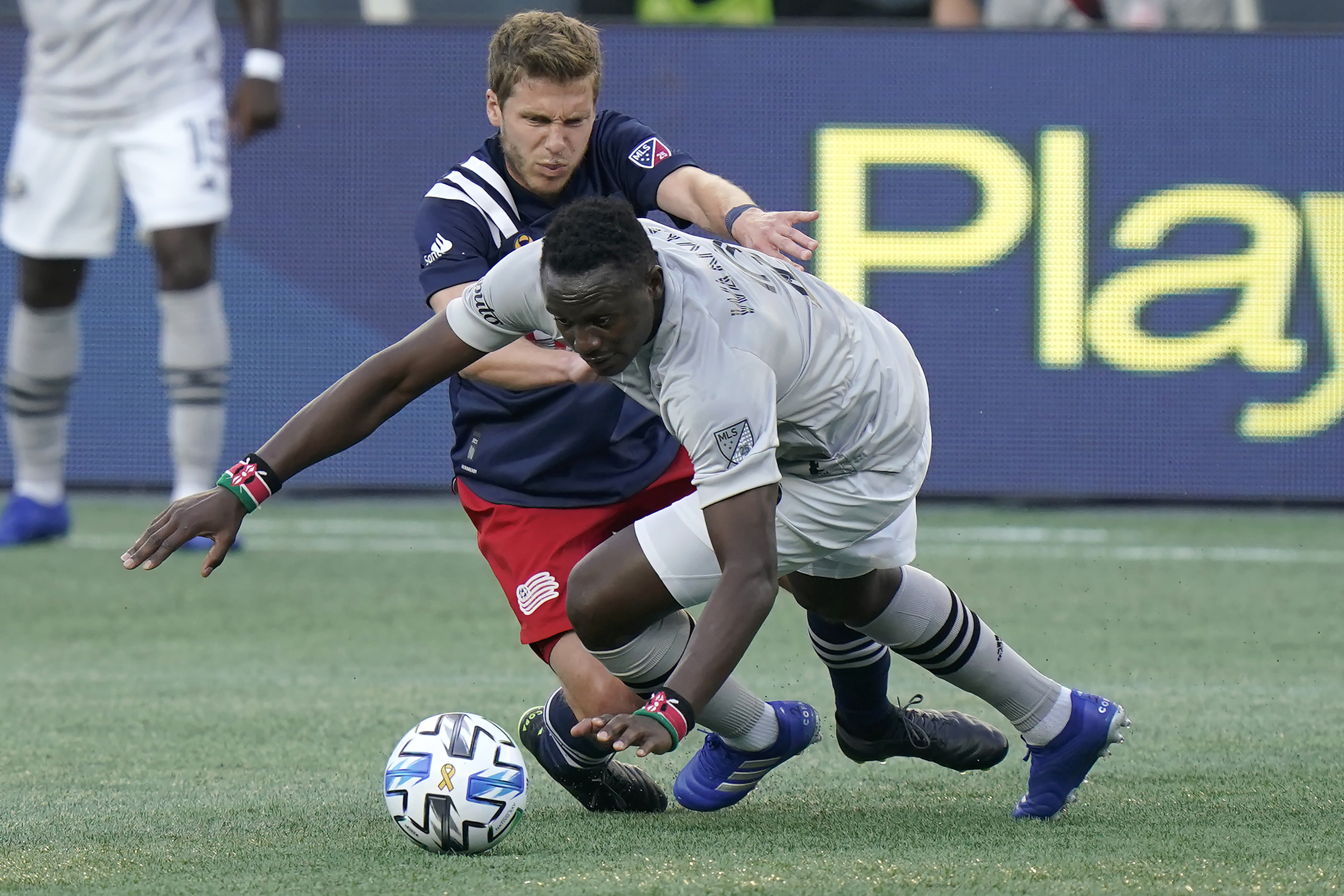 Montreal Impact's Victor Wanyama, right, and New England Revolution's Scott Caldwell, left, vie for control of the ball during the first half of an MLS soccer match, Wednesday, Sept. 23, 2020, in Foxborough, Mass. (AP Photo/Steven Senne)