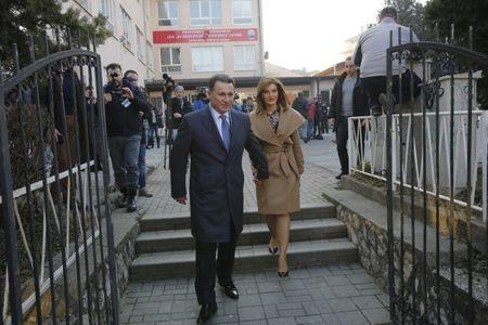 Leader of Macedonian ruling party VMRO-DPMNE and former Prime Minister Nikola Gruevski leaves a polling station with his wife Borkica after casting his vote during elections in Skopje, Macedonia, December 11, 2016. REUTERS/Ognen Teofilovski