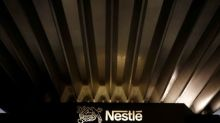 Nestle sets margin goal, to speed up buybacks