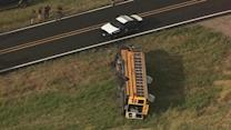 Texas school bus overturns, injuring at least 12 children