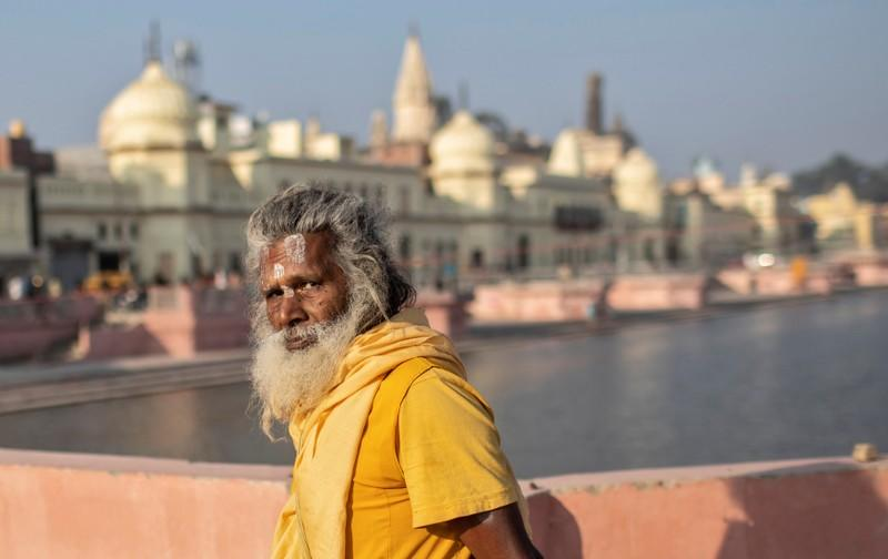 A Hindu priest leaves after performing prayers on the banks of Sarayu river after Supreme Court's verdict on a disputed religious site, in Ayodhya