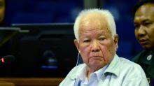 Top Khmer Rouge leader denies genocide at close of UN-backed trial
