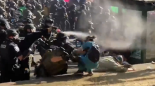 Seattle protests: Nurse hit with pepper spray while trying to help man pushed over by police