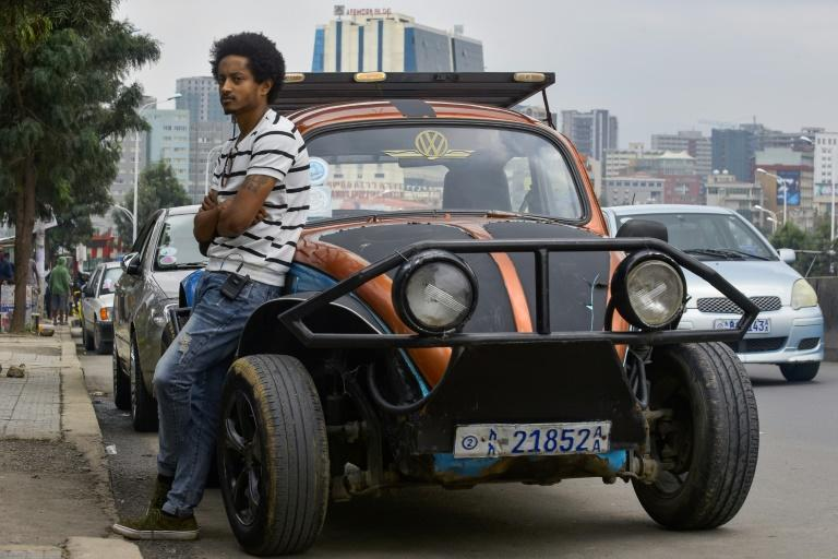Robel Wolde extensively restored a beat-up 1967 Volkswagen Beetle that he bought from a friend for 50,000 Ethiopian birr (about 1,540 euros, $1,700) (AFP Photo/MICHAEL TEWELDE)