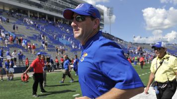 Kansas reaches $2.55M settlement with ex-coach