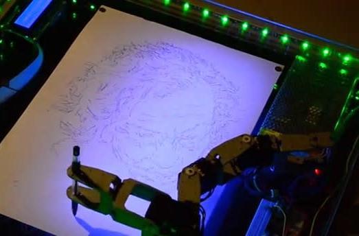 Watch a creepy robot draw an even creepier joker