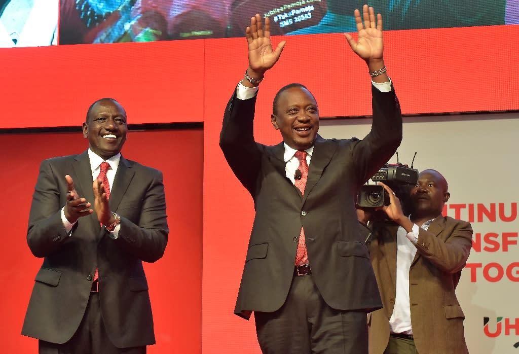 Deputy President William Ruto, left, with his running mate President Uhuru Kenyatta in June