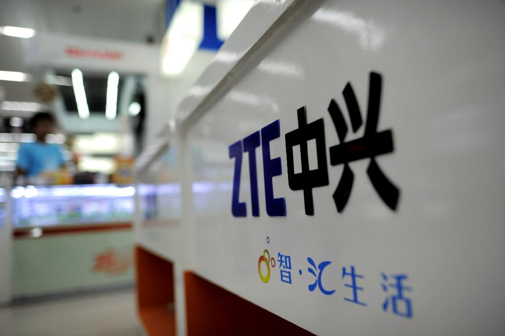 ZTE will pay $892 million, while another $300 million in penalties are suspended for seven years (AFP Photo/)