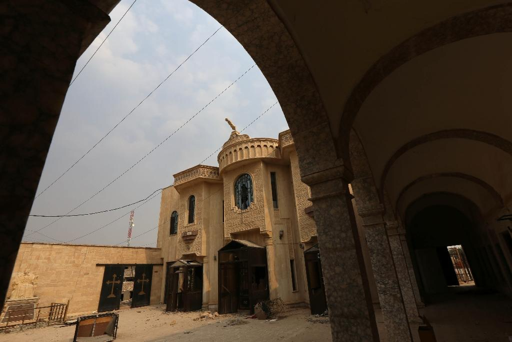 The damaged Church of Mart Shmony, shown on October 24, 2016 is in the Iraqi town of Bartella, one of the Christian towns near Mosul that Iraqi forces have retaken from the Islamic State (AFP Photo/Safin Hamed)
