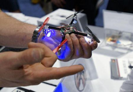 A vendor demonstrates the Micro Drone for a prospective retailer at the International Consumer Electronics show (CES) in Las Vegas