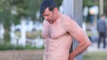 Hugh Jackman's Abs Appear as Chiseled as Ever While Showering on the Beach