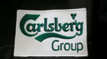 Carlsberg sees 2020 profit fall as lockdowns bite, suspends share buyback
