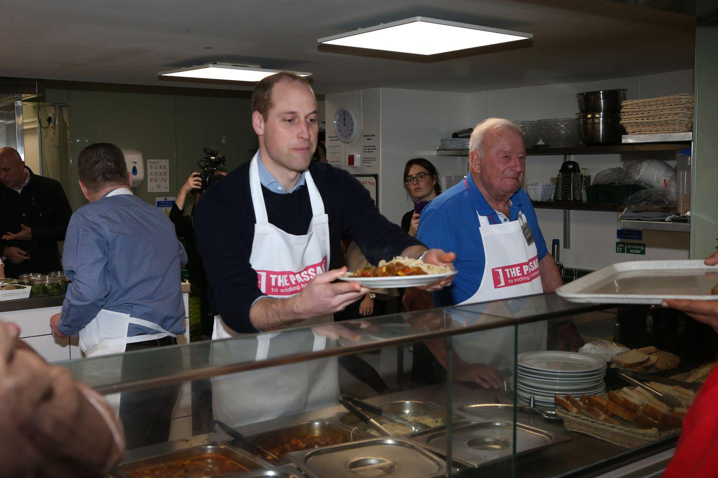 William Cooks at a Homeless Shelter He Visited with Princess Diana