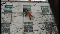 Rescue footage: Firefighters save woman jumping from window