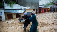 Twin storms track toward US as 13 killed in Haiti, D.Republic