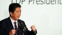 Japan's Abe says has met key goal on jobs, distances himself from BOJ inflation target