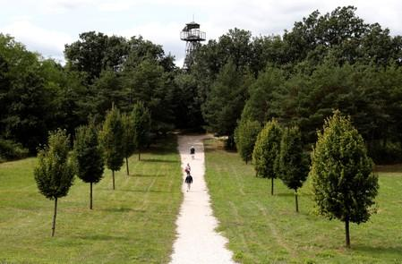 People walk at the Pan-European Picnic Memorial Park in Sopronkohida