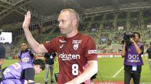 Former Spain playmaker Iniesta makes debut in Japan