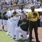 Major League Baseball player kneels during national anthem in defiance of Donald Trump