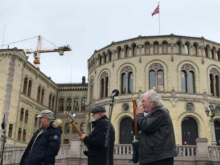 Street musicians play in the front of the Parliament in Oslo, Norway March 20, 2017. REUTERS/Nerijus Adomaitis