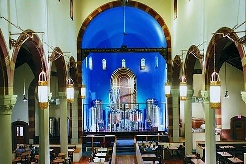 """This former church built in 1902 was the perfect spot to erect a more modern sanctuary—of beer. Working to preserve as much of the unique church as possible, the original stain glass from St. John the Baptist Church still adorns the walls—even the pews have been worked into the brew house's design. <a href=""""https://churchbrew.com/"""" rel=""""nofollow noopener"""" target=""""_blank"""" data-ylk=""""slk:churchbrew.com"""" class=""""link rapid-noclick-resp"""">churchbrew.com</a>"""