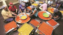 For counting day in Punjab, sweet shops stack celebratory 'ladoos'