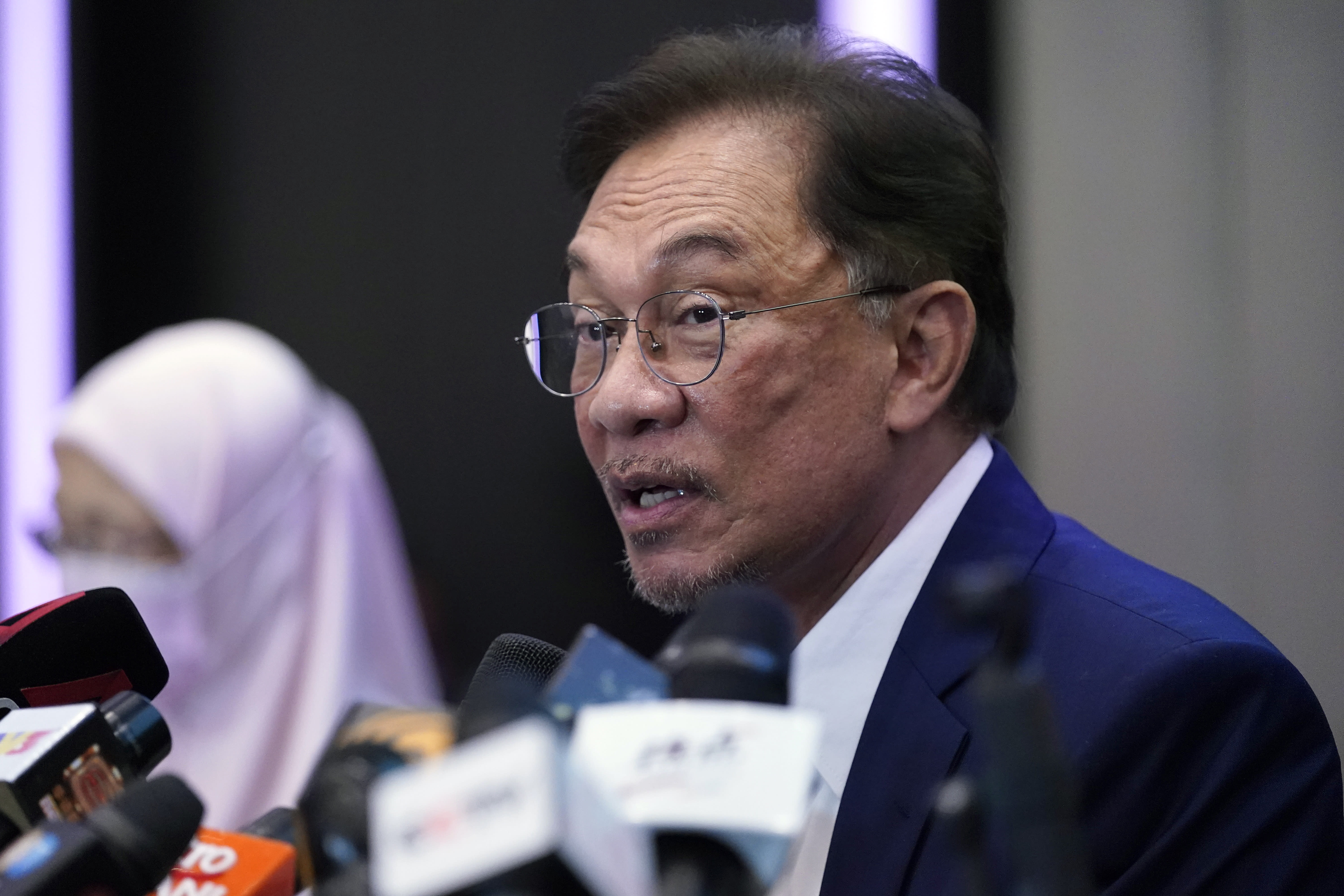 """Malaysia's opposition leader Anwar Ibrahim speaks during a press conference in Kuala Lumpur, Wednesday, Sept. 23, 2020. Anwar said he has secured a majority in parliament to form a new government that is """"strong, stable and formidable."""" (AP Photo/Vincent Thian)"""