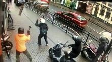 Brave hairdresser fights off moped raiders with shop sign