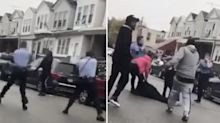 Horrific moment man shot 10 times in front of his family by Philadelphia police